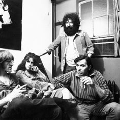 Bill Graham (on right), owner of Filmores East & West, chats with members of rock group Jefferson Airplane, Paul Kantner, Grace Slick and the Grateful Dead's Jerry Garcia, 1970.