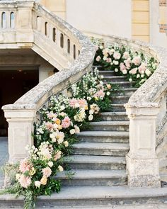 If a winding outdoor staircase is part of your ceremony aisle, considering lining the edges with in-season blooms. #Floral #Weddings #WeddingStaircase #Flowers   Martha Stewart Weddings - 20 Summer Wedding Ceremony Ideas You and Your Guests Can Get Behind