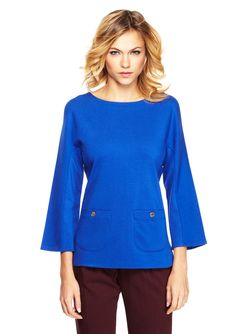 Ainsley Tunic Top Mid-weight, ponte knit top; Three-quarter dolman sleeves with bell cuffs; Front features two patch pockets with buttons; Collar has contrast lining; Back features exposed zipper with metallic fringe pull; Sides have split hem; Unlined Women #Shirts