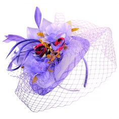 Lexi Fascinator available at #VillageHatShop also available in Mint Green
