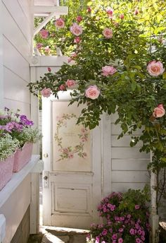a beautiful shabby chic porch and entry door