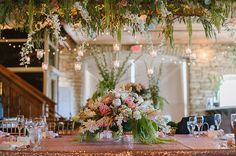 Mint and pink wedding. Hanging candles. Minnesota rustic wedding. Mayowood Stone Barn, Rochester. Anna Page Photography.