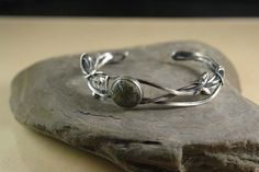 """Moss agate known as the """"gardener's stone"""" set in a freestyle bracelet."""