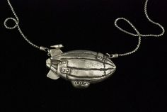 New Pieces for 2015 ShowsBirdie Blimp Silver Necklace is at Bainbridge Arts and Crafts Gallery