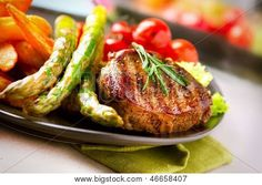 Grilled Beef Steak Meat with Fried Potato, Asparagus and Cherry Tomato. Steak Dinner. Food. BBQ Grill. Berbecue