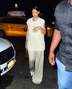 Rihanna dresses in an all white ensemble in heavier fabrics that are perfect for this transitional weather as we move into Fall.