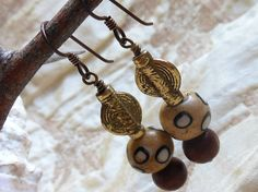 African style earrings, tan, brown and antique brass earrings, hand painted bone beads, wooden beads, antique brass, noibium earring wires by #EyeCandybyCathy on Etsy