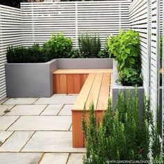 Cement boxes and thin wood along the north + east side of yard    modern Garden by Garden Club London #Moderngardens