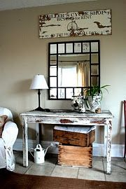 The mix of shabby, vintage materials with the elegant mirror makes this my supreme entry decor.