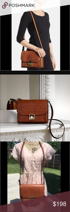 🎉SALE🎉 Ivanka Trump Hopewell Shoulder Bag 🆕Ivanka Trump Hopewell Shoulder Bag.  A perfectly proportioned shoulder bag with a boxy silhouette easily transitions from day to evening.  This Top Zip Croc-embossed Shoulder Bag is a gorgeous chestnut/brown family color.  Perfect for the Fall season to go with any outfit.  Beautiful piece.  Don't miss out. Top flap with clasp closure. Adjustable shoulder strap. Slip pocket under flap. Three interior compartments; interior zip and smartphone…