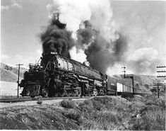 """Union Pacific Railroad's 4-8-8-4 """"Big Boy"""" class steam locomotive #4019 and  string of PFE cars in Echo Canyon, Utah. First of this type locomotive built in  1941 for freight service."""