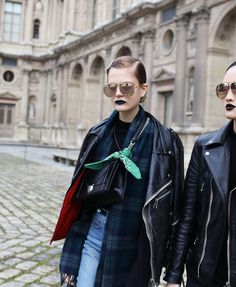 Trending: wrapped, high crossbodies. Caroline Schurch and Jing Wen in Christian Dior sunglasses. Paris fashion week street style.