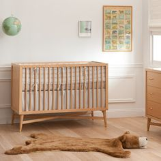 Mid century mod reproduction natural wood crib. Also can order toddler bed conversion.