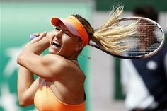 Russia's Maria Sharapova returns the ball to Canada's Eugenie Bouchard during their semifinal match of the French Open tennis tournament at the Roland Garros stadium, in Paris, France, Thursday, June 5, 2014. (AP Photo/Darko Vojinovic) ▼5Jun2014AP|2012 champ Sharapova awaits Halep in French final http://bigstory.ap.org/article/maria-sharapova-makes-it-back-french-open-final #Maria_Sharapova #French_Open #Internationaux_de_France_de_tennis #Torneo_de_Roland_Garros