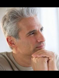 Handsome Man Pondering his Gray Hair.