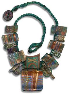 Sherrill Kahn necklace     Sherrill uses fabric, tyvek, clay, metal, beads, and ribbons in her jewelry.      http://www.impressmenow.com/jewelry.html