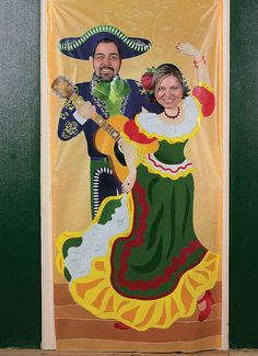 Fiesta Couple Photo Door Banner. Made of vinyl, it has cutouts for two guest and makes a great photo op at a party with a Fiesta theme! Measures 3 ft. x 6 ft.