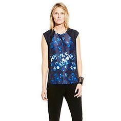 FLORAL CENTER SEAM TOP-With an enchanting blossom print and solid chiffon sides, the gorgeous Floral Center Seam Top is femme and fresh. It's a masterpiece with jeans and a pave wrist cuff.  <li> 100% Polyester