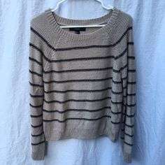 Striped Sweater This is a super cute sweater and perfect for fall and winter! I love it and would keep it, but I lost weight and it no longer fits me. It's a fan/beige with navy blue stripes. It's in excellent condition other than the pull on the sleeve shown in the last picture! Forever 21 Sweaters Crew & Scoop Necks