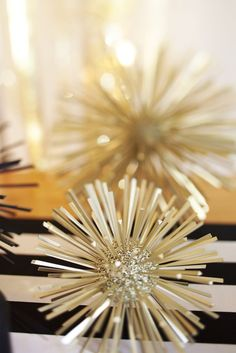 Easily make these celestial spikes with glitter, Styrofoam balls, and spray-painted toothpicks. Great addition to your New Year's Eve party!