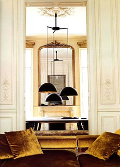 Molding on walls and black chandelier