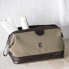 Leather & Suede Dopp Kit | Constructed of soft taupe ultrasuede and trimmed in deep brown leather, this essentials kit holds everything for travel and more: a 6-piece manicure and grooming set, shaver, clipper, compact screwdriver, scissors, file, and comb.