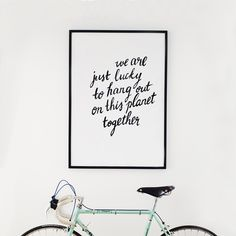 Interior. White interior. Scandinavian home. Wall gallery. Print design. Graphic design. Lettering. Typography. Home inspiration. Home styling. Bianchi bicykle