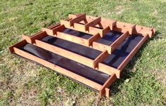 Very tidy way to have a raised bed with geometric interest, plus it separates the different areas nicely.  Would look great even if it's all one thing (like strawberries).