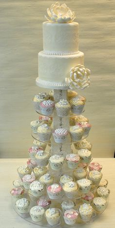 Vintage lace cupcake tower with 2 tier wedding cake on the top - The cake Zone.     I like idea if no pink, but more coral & mint/ teal