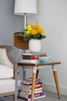Bette: bedside table - this is just too cute for me to think of anything funny to say, besides i really just want to read all the books under the vase and under the chair.    David: I generally don't trust chairs behaving like tables ( long story ) but this is so adorbs I might concede. Every book on there is either about hot chocolate or how to maximize cuddling in cottages.