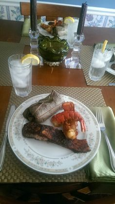 Salmon and Lobster Tails cooked on cedar planks and rice and veggies ...