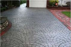 """""""Stamped Concrete is concrete that is patterned and/or textured or embossed to resemble brick, slate, flagstone, stone, tile, wood, and various other patterns and textures. The ability of stamped concrete to resemble other building materials makes stamped concrete a less expensive alternative to using those other authentic materials such as stone, slate or brick."""" 