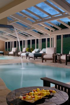 The indoor swimming pool frames the outdoor scenery through a sunny atrium. #Jetsetter One Ski Hill Place (Breckenridge, Colorado)