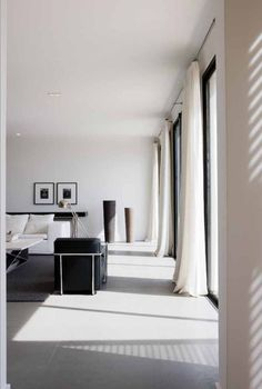Tall white draping gauzy curtains that puddle slightly on the floor. These would have to go with blinds.