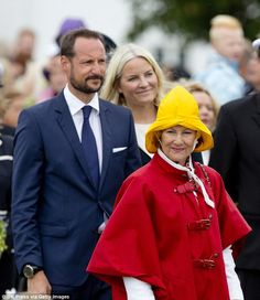The Queen, who turns 79 last week, seemed prepared for the weather with a waterproof red mac and a yellow rain hat