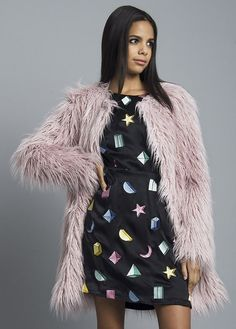 Stay warm and colorful this winter in this cute fur coat. Rock it with our Polka Dot Mini Dress! Returns and Exchanges Policy Shipping Specifications: Item is s