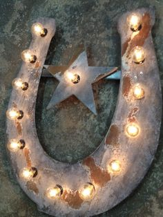 I want one of these for the barn..So cool!  Horse shoe with star lighted metal marble by WestVintageTradingCo, $155.00