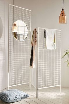 This metal room divider is ideal for storing clothes as well as putting your fave accessories on display.
