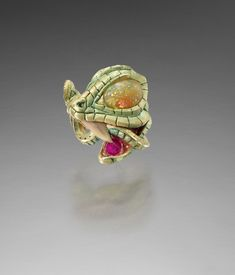 Kevin Coates X THE SERPENT'S TOOTH 18K gold with patination, Ethiopian opal, ruby, fossilised shark-tooth (Palaeozoic)