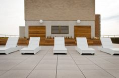 Loll Designs' Chaise 405 Sunbeds on the River Tower Condos roof top in Minneapolis.