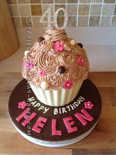 Coolest 40th Birthday Giant Cupcake... This website is the Pinterest of birthday cake ideas
