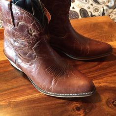 Dingo Leather Bootie 8.5 Brand new with tags brown leather Bootie. Dingo brand. Inside zipper. 8.5.             Category: Ankle Boot, Shorty, Bootie, Cowgirl Boot Dingo Shoes Ankle Boots & Booties