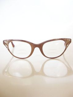 cat eye glasses... I can't believe I wore these in the 50's... unfortunately I don't have them any more... the plastic deteriorated... D