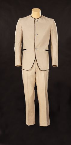 """Ringo Starr Beatles vintage stage-worn D. A. Millings custom-made suit. (c. 1963) """"The Fab Four"""" lads from Liverpool emerged in the 60s not only as Rock & Roll royalty, but as fashion trendsetters climbing to the top of the pop charts as clean-cut """"Mods"""" in mop-top haircuts and signature tailored, collarless suits like this one.   Lot 39  https://www.profilesinhistory.com/auctions/rock-roll-auction-59-2/"""