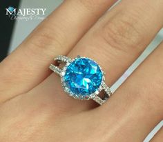 Round Cut Blue Topaz and White Diamond Halo Cocktail Ring.
