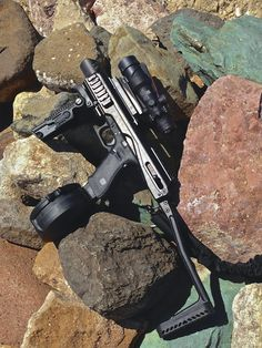 Glock 17 with 50 round drum, FAB industries Carbine adapter, Trijicon 4x32 scoop boom zombies are dead