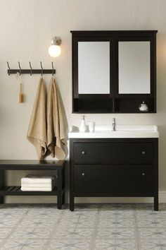 The IKEA HEMNES bathroom series is a traditional approach to a tidy bathroom. It has lots of smart ideas like a mirror cabinet and a sink cabinet with plenty of stylish storage below, to help you organize your bathroom, no matter what size it is.