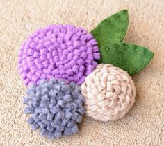How to Make Felt Flowers - use many flowers to cover a wreath form or a small cluster to adorn just about anything