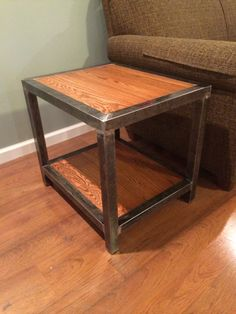 "Welded end table. 1 1/2 square tubing and 3/4"" red oak."