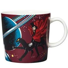 """This mysterious Moomin mug by Arabia from 2018 features the Hobgoblin and his panther. It's beautifully illustrated by Tove Slotte and the illustration can be seen in the original book """"Finn Family Moomintroll"""" by Tove Jansson. Moomin Shop, Moomin Mugs, Troll, Moomin Cartoon, Helsinki, Tove Jansson, Hobgoblin, Porcelain Mugs, Valencia"""